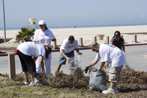 "Some of the 1,100 volunteers remove some of the 20,000 pounds of invasive plants, part of the ""Preserve Our Parks"" program at Huntington State Beach, Calif., Saturday, April 16, 2011. In its' third year Coca-Cola and Stater Bros. Supermarkets have initiated an environmental stewardship program to benefit California State Parks and have raised over $300,000 to date, part of the goal of $750,000. (AP Photo/Stater Bros. Supermarkets, Coca-Cola Refreshments, Susan Goldman, handout)"