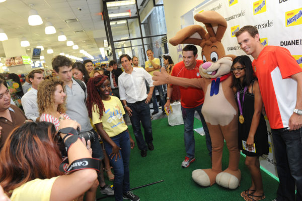 Consumers and fans gather at a Duane Reade in New York to greet gold medalists and champion tennis players Bob and Mike Bryan, right, along with the Nesquik bunny, Thursday, Aug. 23, 2012, to celebrate the brothers' win in London.   The Bryan Brothers later took on the FDNYÕs ace ping pong players at the Nesquik FDNY Foundation Charity Ping Pong tournament, benefiting the FDNY Foundation.  (Diane Bondareff/Invision for Nesquik/AP Images)