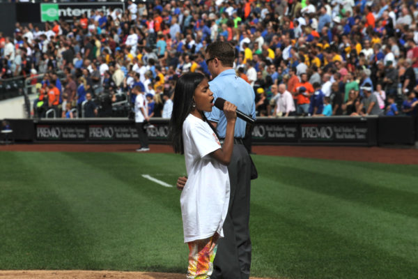 Huchella DelaCruz poses with the Nesquik Bunny after she sang God Bless America during the 7th inning stretch at Citi Field in New York, Sunday, Sept. 15, 2013, during a day benefitting Madison Square Boys & Girls Club.  (Photo by Diane Bondareff for Nesquik)
